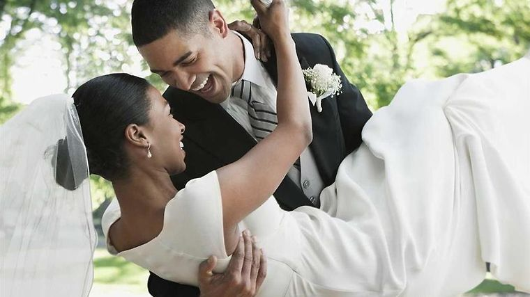 Hilton Garden Inn Benton Harbor Room Groom holding bride