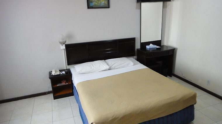 Batu Burok Beach Resort Room