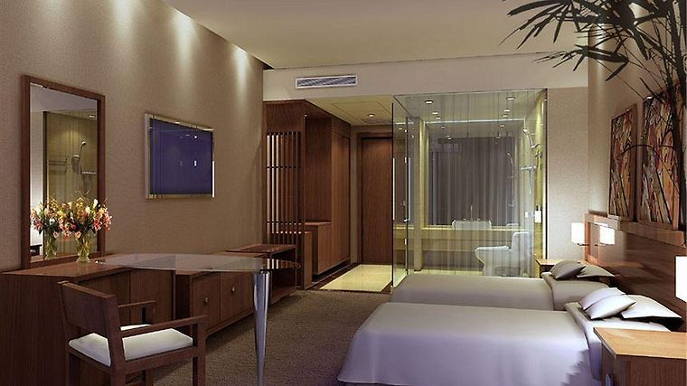 Tailong Plaza Business Hotel Room